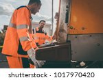 garbage removal men working for ... | Shutterstock . vector #1017970420