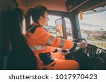 garbage removal worker driving... | Shutterstock . vector #1017970423