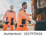 two garbagemen working together ... | Shutterstock . vector #1017970426