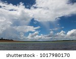 rain falling from the cloud in... | Shutterstock . vector #1017980170
