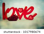 flowers with word love | Shutterstock . vector #1017980674