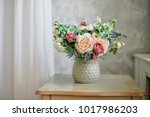 flowers in vase in gray interior | Shutterstock . vector #1017986203