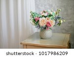 flowers in vase in gray interior | Shutterstock . vector #1017986209