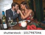 romance in the restaurant on... | Shutterstock . vector #1017987046