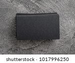 stack of black business cards.... | Shutterstock . vector #1017996250
