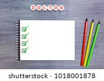 on the table is a white... | Shutterstock . vector #1018001878