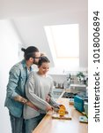 young couple making breakfast... | Shutterstock . vector #1018006894