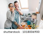 young couple making breakfast... | Shutterstock . vector #1018006900