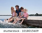 family playing together on dock | Shutterstock . vector #1018015609