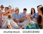 friends toasting newlywed couple | Shutterstock . vector #1018018480