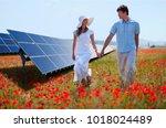 couple walking by solar panels | Shutterstock . vector #1018024489