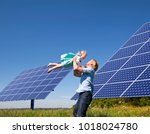 father and daughter by solar... | Shutterstock . vector #1018024780