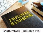 employee handbook on a wooden...   Shutterstock . vector #1018025446