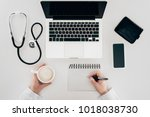 partial view of doctor at... | Shutterstock . vector #1018038730