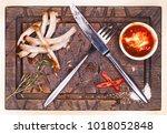 pork bone with knife and fork ... | Shutterstock . vector #1018052848