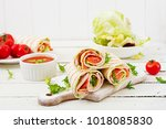 tortilla wrap with ham  cheese... | Shutterstock . vector #1018085830