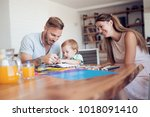 mom and dad drawing with their... | Shutterstock . vector #1018091410