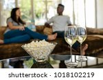 bowl of popcorn and wine... | Shutterstock . vector #1018102219