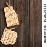 Small photo of Two pieces of matzah or matza on a vintage wood background with copy space or text space. Perfect for your Passover design
