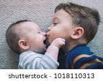 toddler baby boy kisses his... | Shutterstock . vector #1018110313