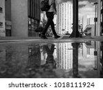 Man Walking In The Sidewalk In...