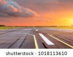 runway at the airport the... | Shutterstock . vector #1018113610