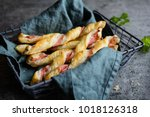 twisted puff pastry sticks with ... | Shutterstock . vector #1018126318