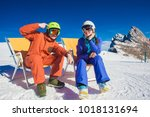 a couple on mountain vacation.... | Shutterstock . vector #1018131694