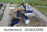 aerial view on tiny houses in... | Shutterstock . vector #1018141858