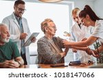 image of young medic taking... | Shutterstock . vector #1018147066
