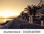 sidewalk by the sea with a... | Shutterstock . vector #1018160584