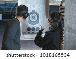 shooting instructor pointing on ...   Shutterstock . vector #1018165534