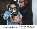 instructor helping customer in... | Shutterstock . vector #1018165666