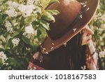 beautiful white flowers on hat... | Shutterstock . vector #1018167583