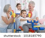 grandparents and little... | Shutterstock . vector #1018185790