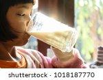 hand kids holding cup of  milk... | Shutterstock . vector #1018187770