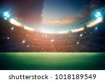stadium in lights and flashes... | Shutterstock . vector #1018189549