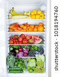 opened refrigerator full of... | Shutterstock . vector #1018194760
