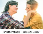 happy gay couple looking at... | Shutterstock . vector #1018210309