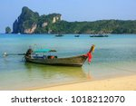 longtail boat anchored at ao... | Shutterstock . vector #1018212070