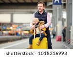 cute little boy and his father... | Shutterstock . vector #1018216993