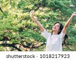 woman standing stretch her arms ... | Shutterstock . vector #1018217923