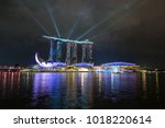 The light up laser on the Marina bay sand at night