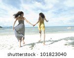 woman hang out  together sand by sea edge on blue sky background - stock photo