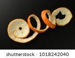 image of orange peel on dark...   Shutterstock . vector #1018242040