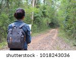 a backpacking lady with natural ... | Shutterstock . vector #1018243036