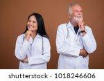 studio shot of senior man... | Shutterstock . vector #1018246606