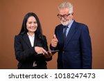 studio shot of senior... | Shutterstock . vector #1018247473