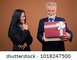 studio shot of senior... | Shutterstock . vector #1018247500