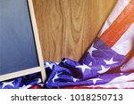 chalkboard and usa flag on... | Shutterstock . vector #1018250713